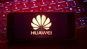 Huawei was allowed a limited roll in Britain's 5G network (PA)