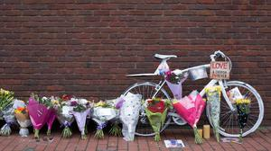 A bike and floral tributes in Caledonian Road, Islington, north London, after Alan Cartwright, 15, was stabbed to death (Daniel Leal-Olivas/PA Wire)