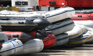 Boats in a secure compound in Dover which have been seized after being intercepted in the Channel while carrying migrants from the French coast to England