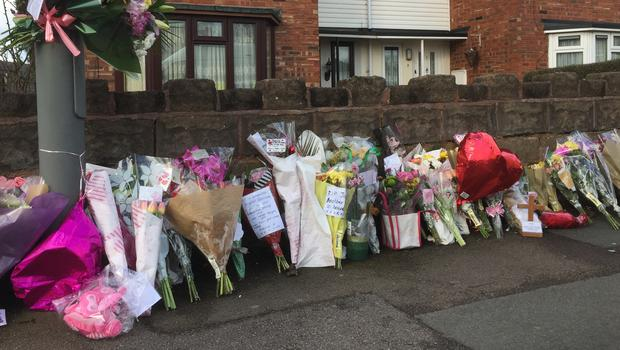Flowers outside the house in Wolverhampton from where Jasmine Forrester was taken to hospital in February (Matthew Cooper/PA)