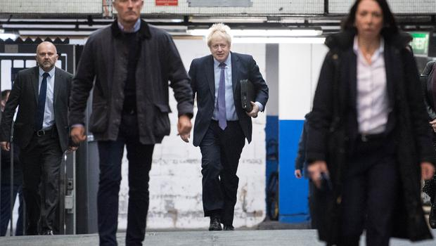 Prime Minister Boris Johnson arrives at Euston station in London, as he heads to Telford for the launch of his party's manifesto (Stefan Rousseau/PA)