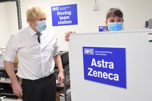 Boris Johnson is shown the distribution operation for sending the Oxford/Astrazeneca coronavirus vaccine out to local clinics during a visit to Barnet FC's ground (Stefan Rousseau/PA)