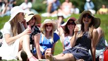 Spectators enjoy the sun on day One of the Wimbledon Championships at the All England Lawn Tennis and Croquet Club, Wimbledon.