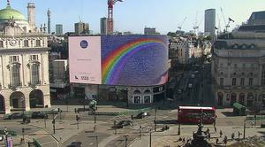 The Piccadilly Lights interactive mosaic art project, Rainbows For The NHS, in Piccadilly Circus (Ocean Outdoors/PA)