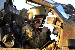 Prince Harry wearing his monocle gun sight as he sits in the front seat of the cockpit in an Apache Helicopter (John Stillwell/PA)