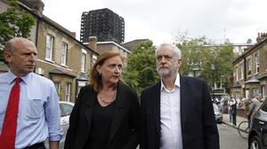 Jeremy Corbyn visits the scene of the fire (Alastair Grant/AP/PA)