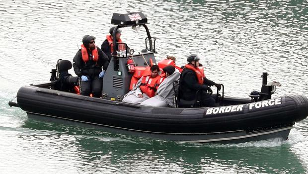 A group of people thought to be migrants are brought to shore by Border Force officers at the Port of Dover in Kent (Gareth Fuller/PA)