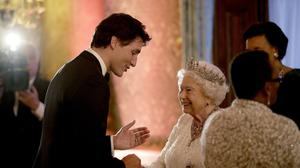The Queen and Canadian Prime Minister have discussed the 'state of the world' in a phone call (Matt Dunham/PA)