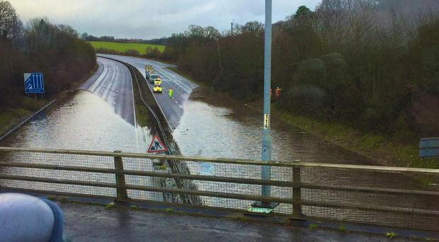 Flooding on the M23 near Crawley, West Sussex, as heavy rain caused severe disruption in parts of southern England (@moth_effect/PA)