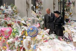 The Queen and the Duke of Edinburgh view the floral tributes to Diana, Princess of Wales, at Buckingham Palace (John Stillwell/PA)