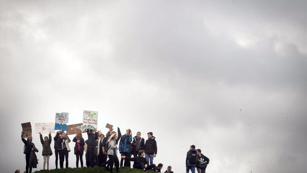 Students take part in the climate change protest in Cambridge (Stefan Rousseau/PA)