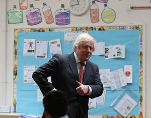 Prime Minister Boris Johnson joins a socially distanced lesson (Steve Parsons/PA)
