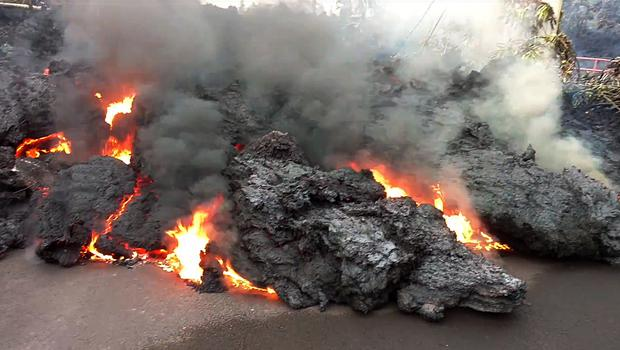 A lava flow advancing down a road in the Leilani Estates, Hawaii ((Scott Wiggers/Apau Hawaii Tours via AP)