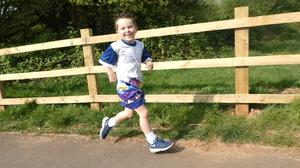 Henry Edwards, five, who has taken part in the 2.6 Challenge by running 26 miles over 10 days (Katey Edwards/PA)