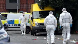 Police at the scene of the fatal shooting (Peter Byrne/PA)