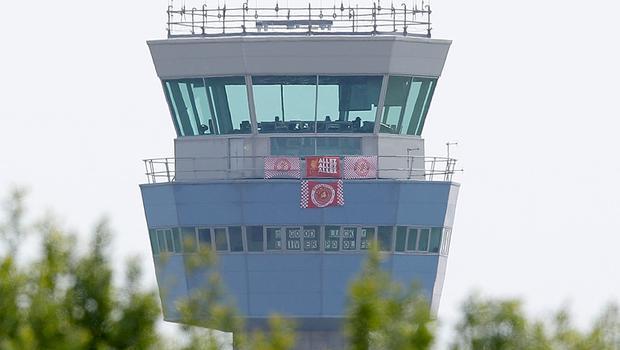 A message of support for the players on the control tower at Liverpool John Lennon Airport - but 1,000 fans may miss the Real Madrid clash (Martin Rickett/PA)