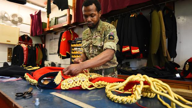A member of the Household Calvary works at Hyde Park Barracks during the Household Cavalry Mounted Regiment preparations for the royal wedding (Kirsty O'Connor/PA)