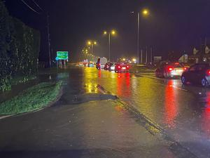 The A40 dual carriageway at Highnam in Gloucester was almost impassable on Wednesday night after heavy rain across England and Wales (Gloucestershire Police/PA)