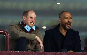William watching Aston Villa with one of the club's former players John Carew. Paul Harding/PA Wire