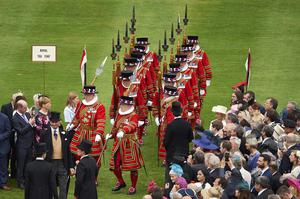 Yeomen of the Guard march at a garden party (Niklas Halle'n/PA)