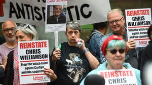 Supporters of Chris Williamson outside the Labour Party head office (Kirsty O'Connor/PA)