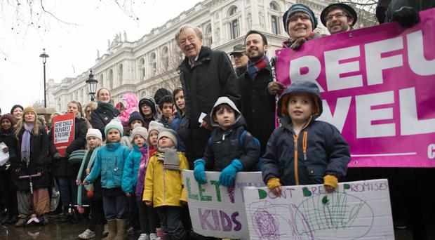 Labour peer Lord Dubs accompanied by religious and community leaders campaigning against the decision to close the Dubs scheme for vulnerable unaccompanied refugee children in Europe (Stefan Rousseau/PA)