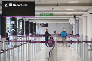 Passengers will have a different holiday experience, with masks and social distancing in place where possible (Jane Barlow/PA)