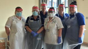 Nurses wearing the visors made by the school at the Norfolk Hospice (Norwich School/PA)