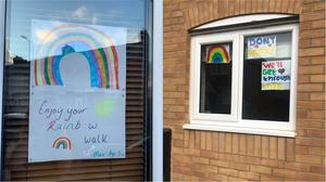 Pictures of rainbows in windows to cheer passers-by (Vicky Corbley and Danielle Oliver)