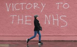 A strong message has been painted on a wall of the Royal Victoria Hospital in Belfast to support those on the front line inside (Niall Carson/PA)
