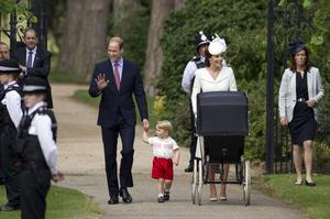 The Duke and Duchess of Cambridge with Prince George and Princess Charlotte in a vintage pram, as they arrive for Charlotte's christening (Matt Dunham/PA)