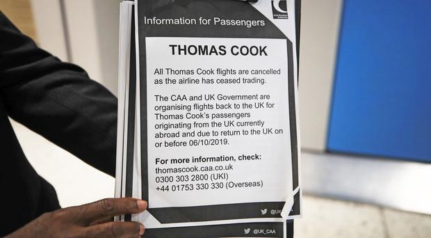 A Thomas Cook information notice at Manchester Airport (PA)