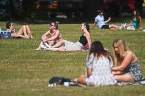 People enjoy the hot weather on London's Clapham Common (Victoria Jones/PA)