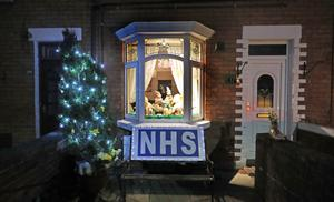 Residents of the St James Road area of Belfast, meanwhile, have put their Christmas decorations up to show their support for the NHS (Niall Carson/PA)