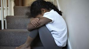 NOTE: PICTURE POSED BY MODEL. Children with mild depression are to be offered therapy via their smartphones (PA)