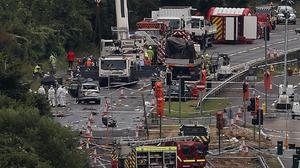 A giant crane removes wreckage of the plane on the A27 at Shoreham in West Sussex