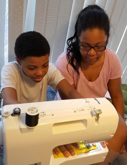 Darius Brown was eight when he was taught to sew bow ties by his sister Dazhai (Joy Brown)