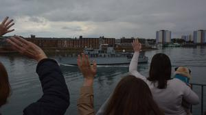 Families wave off HMS Chiddingfold from the Round Tower, Old Portsmouth (Ben Mitchell/PA)