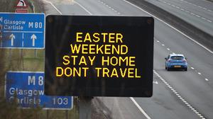 A road sign advising drivers to stay home and not to travel during the Easter weekend (Andrew Milligan/PA)