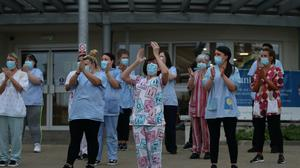 Care home staff applauding as part of Clap for Carers (Andrew Milligan/PA)
