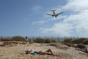 Those holidaying in Spain or its islands have to stay at home for 14 days afterwards following a change in Government rules (Joan Mateu/AP)
