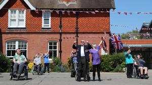 Second World War veteran Len Gibbon, 96, stands to watch a Spitfire fly over the Care for Veterans site in Worthing to mark the 75th anniversary of VE Day (Gareth Fuller/PA)