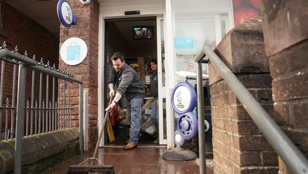 Staff clean up flooding damage at the Co-Op store in Appleby-in-Westmorland, Cumbria (Owen Humphreys/PA)