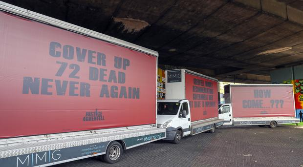 Three billboards by campaign group Justice4Grenfell near the tower (Steve Parsons/PA)