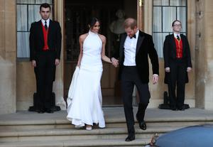 The newly married Duke and Duchess of Sussex heading to their evening reception (Steve Parsons/PA)