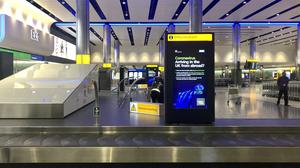 Government warnings about coronavirus in the baggage hall of Heathrow Airport's Terminal 2 (/PA)