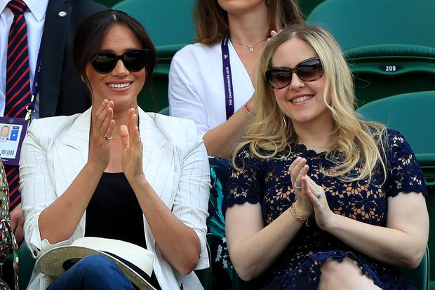 Meghan and friend Lindsay Roth watch Serena Williams at Wimbledon (Mike Egerton/PA)