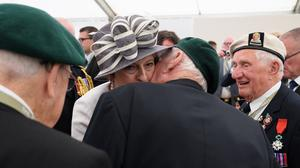 Prime Minister Theresa May is kissed by veteran Robert Yaxley (Leon Neal/PA)