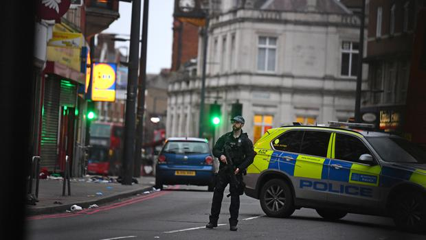 Police forensic officers at the scene in Streatham High Road (Kirsty O'Connor/PA)