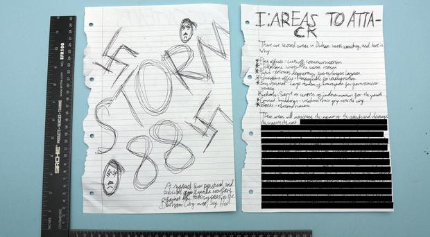 The cover and an excerpt taken from the boy's 'manifesto' was shown to the jury during his trial (handout/PA)